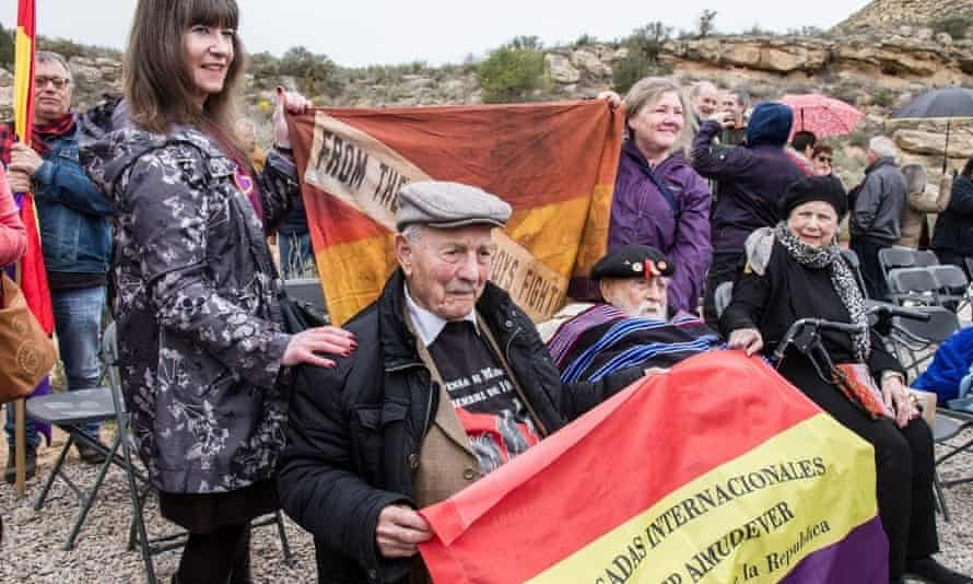 Josep Almudéver with an International Brigades flag with his name on it.