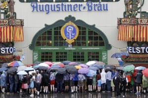 People queue in the rain for the opening of the 2016 Oktoberfest
