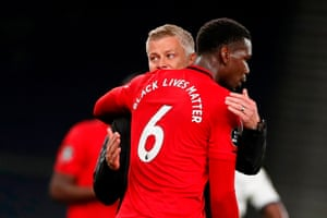 Ole Gunnar Solskjaer hugs Paul Pogba at the end of the match.