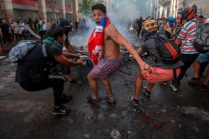 Demonstrators clash with riot police in Santiago, Chile