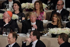 Cardinal Dolan, Melania Trump and others laugh as Hillary Clinton speaks. Donald Trump: not laughing.
