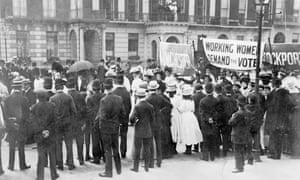 A small crowd watches the Women's Sunday procession as it passes Portland Place, 21 June 1908.