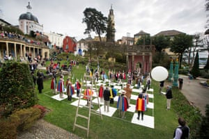Enthusiasts of Patrick McGoohan's 60s TV series The Prisoner re-enact one episode's human chess game at the annual fans' convention in Portmeirion, where the cult show was filmed.