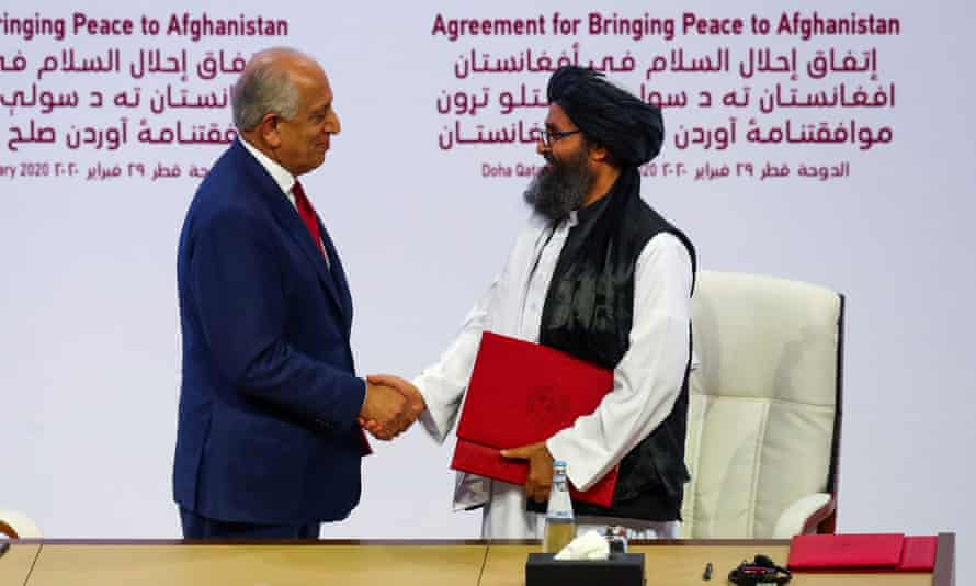 Mullah Abdul Ghani Baradar and Zalmay Khalilzad