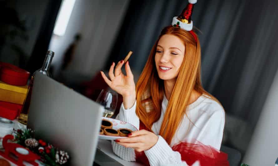 Woman having a Christmas celebration via video call.