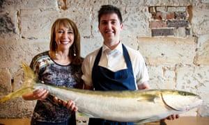 Chef Josh Niland holding kingfish with Food Safari host Maeve O'Meara