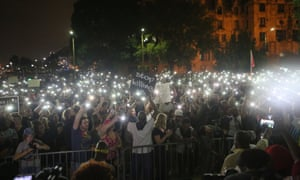 About 1,000 people use their cell phones to light the night at the St Louis Justice Center during an effort to to raise money to bail protesters from jail in St Louis on Monday.