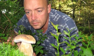 Phil Daoust with a cep, an edible mushroom.