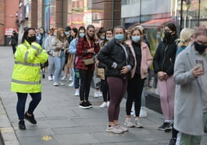Shoppers queuing outside Primark in Belfast, Northern Ireland, where non-essential retail is now re-opening.