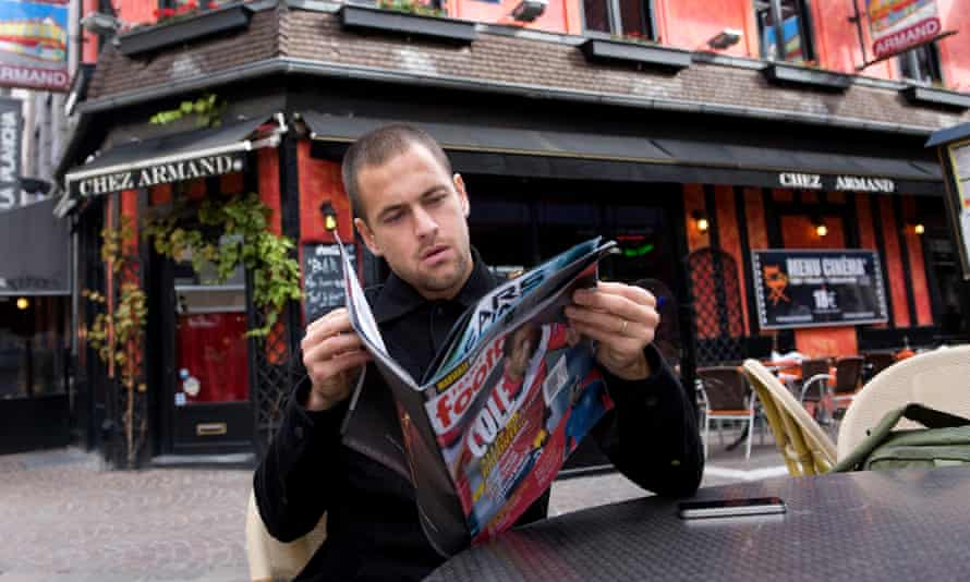 Joe Cole flicks through a copy of France Football that just so happens to feature him on the cover.