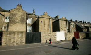 A woman and boy walking in the Manningham district of Bradford