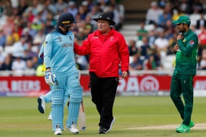 Umpire Marais Erasmus stands between Roy and Babar after words were exchanged as Roy lost his wicket.