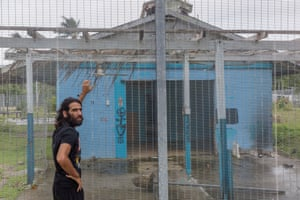 Behrouz Boochani stands outside the abandoned naval base on Manus Island where he and other asylum seekers were locked up for the first three years.
