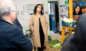 Heidi Allen talks to food bank workers in Leicester.