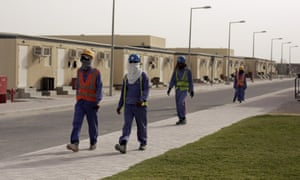 Labourers head back to their housing at the end of their workday, in Doha, Qatar