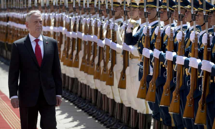 James Mattis reviews a Chinese honour guard during a welcome ceremony at the Bayi Building in Beijing on Wednesday.