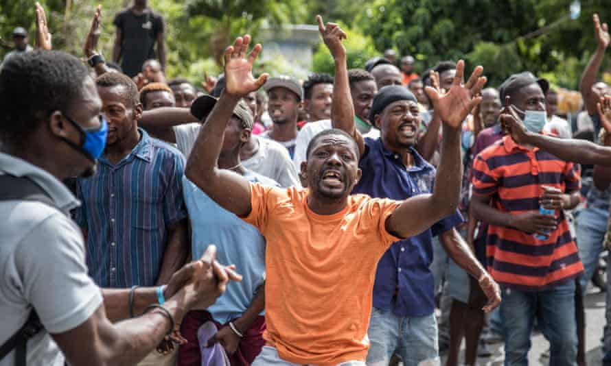 The crowd near the police station, where the gunmen accused of involvement in the assassination of President Jovenel Moise were detained in Port au Prince, Haiti.