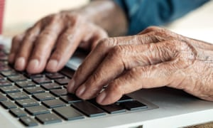 Man's hands at a laptop