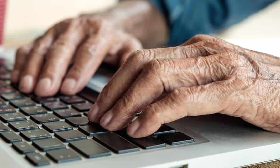 Man's hands at a laptop