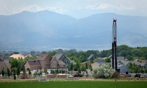 Just off Interstate Highway 25, a fracking drill rig looms over homes in Weld County, Colorado.