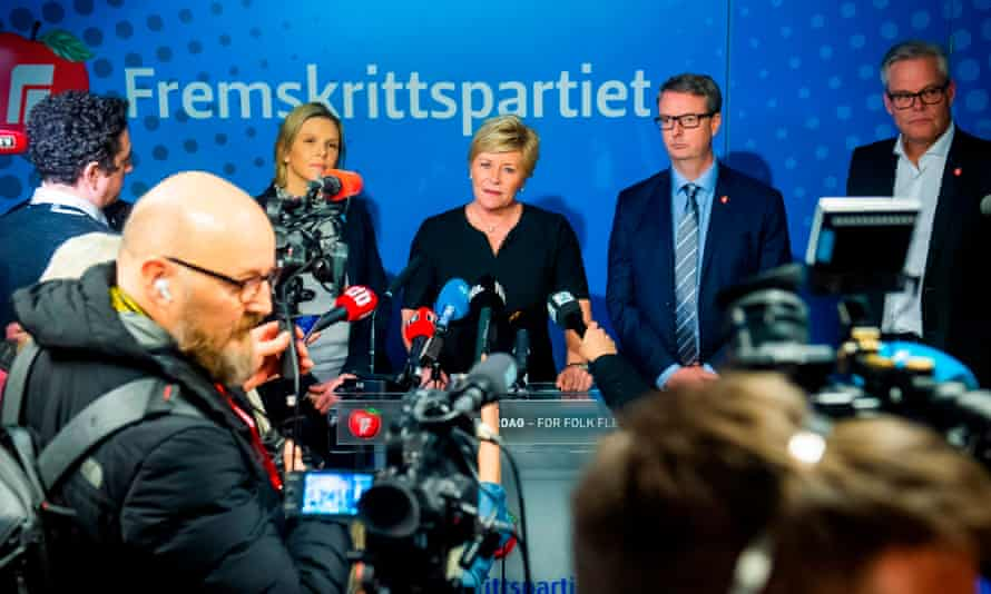 Flanked by party colleagues, the leader of Norway's populist Progress party, Siv Jensen, speaks during a press conference.