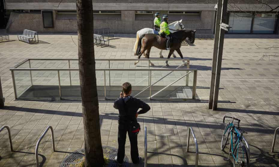 Mounted police on London's South Bank – an area usually thronged with people.