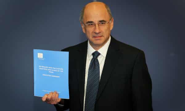 Lord Justice Leveson with the Report from the Inquiry into the Culture, Practices and Ethics of the Press in 2012.