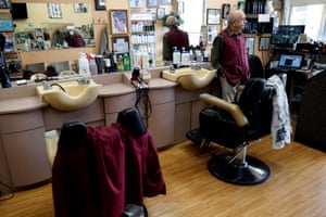 Owner Pino D'erasmo, the Owner of Pino's Hair Salon looks out from his empty shop during the coronavirus outbreak on North Avenue in New Rochelle.