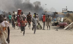 South Sudanese civilians flee fighting in a UN base in Malakal