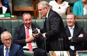 Scott Morrison hands Barnaby Joyce a lump of coal during question time on 9 February.