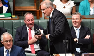 Scott Morrison hands Barnaby Joyce a lump of coal during Question Time in parliament