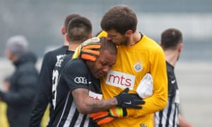 A tearful Everton Luiz is comforted by his Partizan Belgrade team-mate Filip Kljajic as he left the pitch in tears at the racist abuse he suffered in the derby against FK Rad.