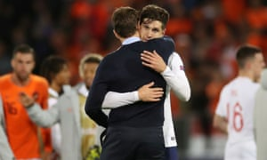 England manager Gareth Southgate consoles John Stones after the final whistle.