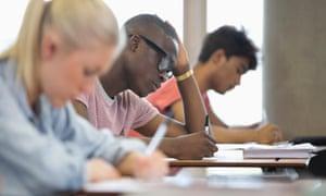 University students taking exam.