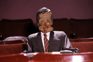 Norman's Spitting Image puppet. The catchphrase 'And why not?' was later used by Norman for the title of his autobiography