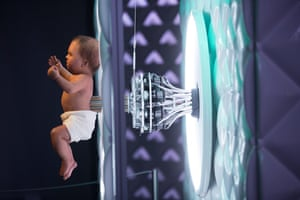 The robotic baby is controlled by a system of cables and actuators that are revealed to visitors as they walk past the exhibit.