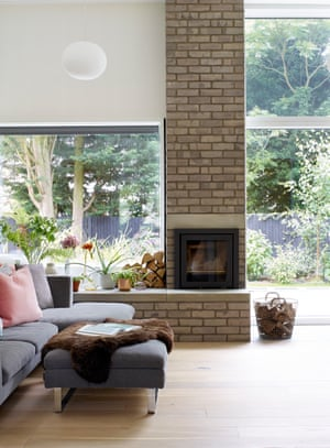 the chimney breast in the living room features the same grey bricks as the facade