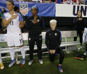 Megan Rapinoe, right, kneels next to team-mates Ali Krieger and Crystal Dunn before the game with Holland in Atlanta.