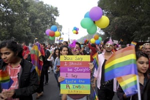 Gay rights activists and their supporters hold colorful balloons and placards as they participate in a gay pride parade in New Delhi