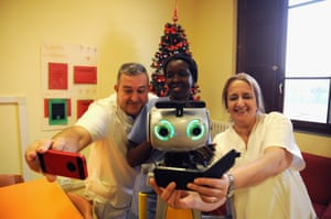 Staff at San Lorenzo can't resist a selfie with their robotic colleague.