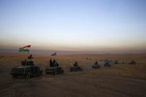 A peshmerga convoy drives towards a frontline in Khazer