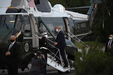 Donald Trump leaves Walter Reed medical center in Bethesda, Maryland, on 5 October.