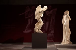 The marble statue of Eros (L) stringing his bow stands among other statues at the Acropolis Museum in Athens.
