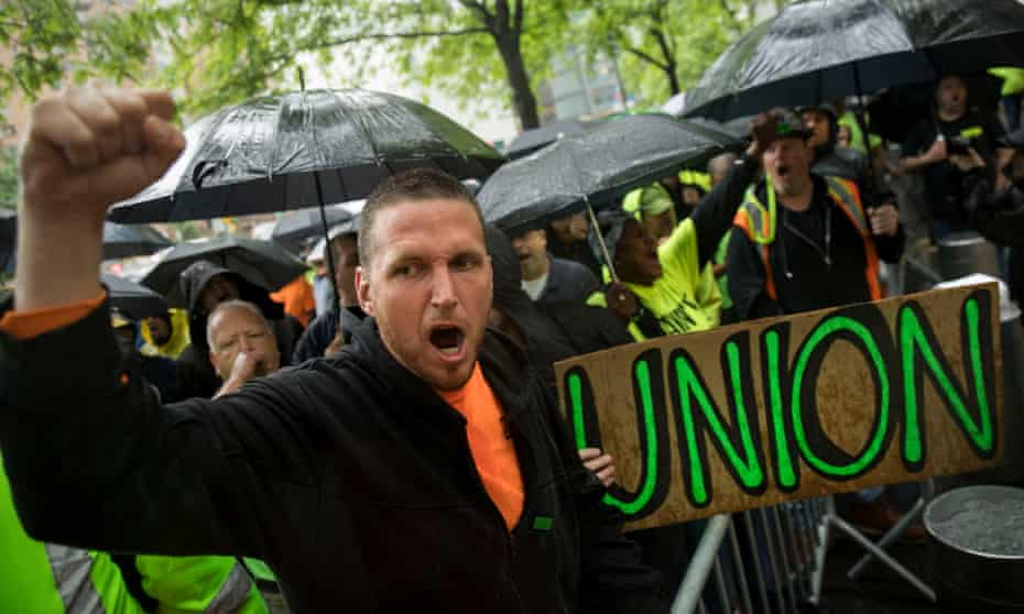 Construction workers and union members hold a rally in Columbus Circle in New York City.