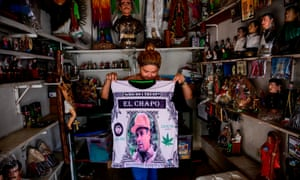 A vendor shows a shirt depicting a portrait of Mexican drug lord Joaquín 'El Chapo' Guzmán at a store next to the narco-saint Jesus Malverde chapel in Culiacan, Sinaloa state, on Monday.