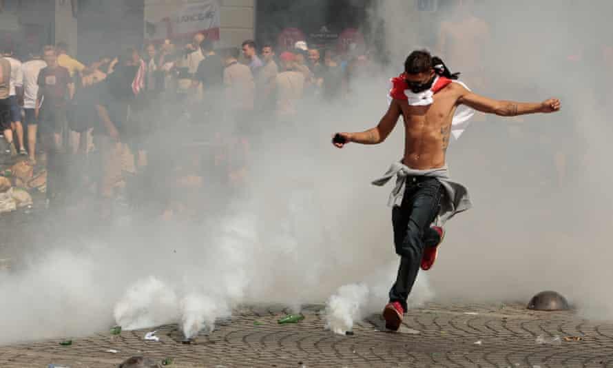 England fan kicks a tear gas canister