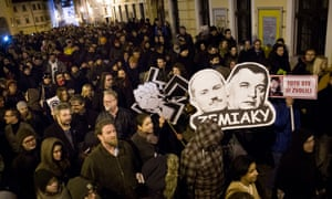 The faces of Kotleba and Jozef Tiso carried during an anti-extreme right rally in Bratislava.
