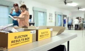Clerks get ready to receive voters inside a polling station in Christmas, Florida on Tuesday.
