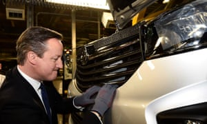 A picture of David Cameron helping to make a Vauxhall Vivaro van in Luton.