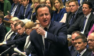 David Cameron gestures as he responds to a question in the House of Commons.